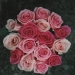 mixes pink roses with tiny pearls.