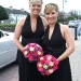 Bridesmaids Bright Bqs against Black Dresses