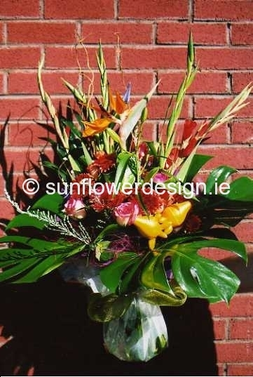 large exotic Bouquet of Strelitzia, Monstera Leaves, Gladioli, Gerbera and Roses